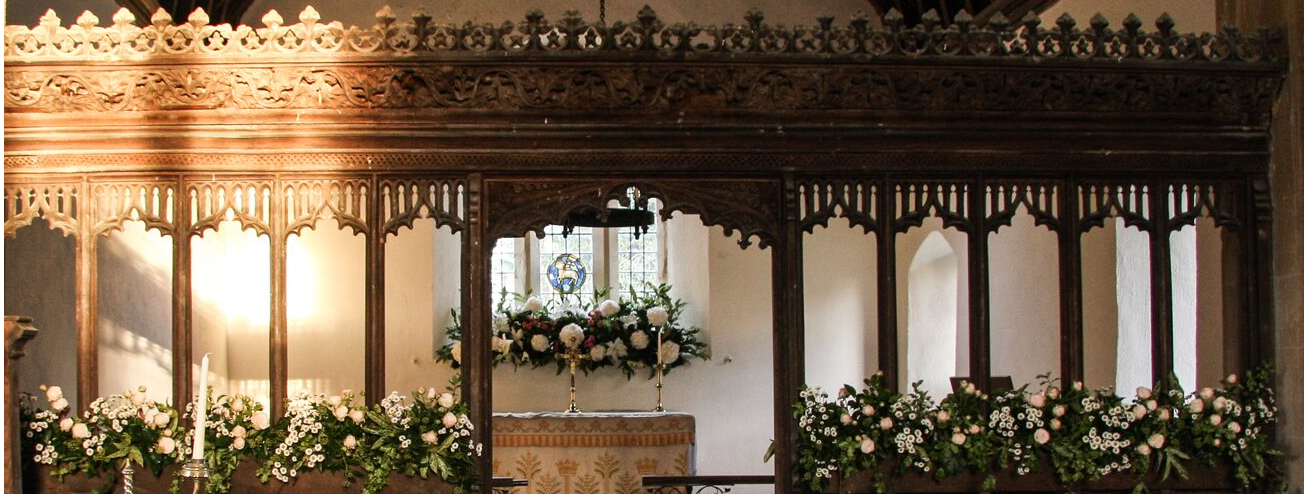 St James Alter and rood screen decorated with flowers