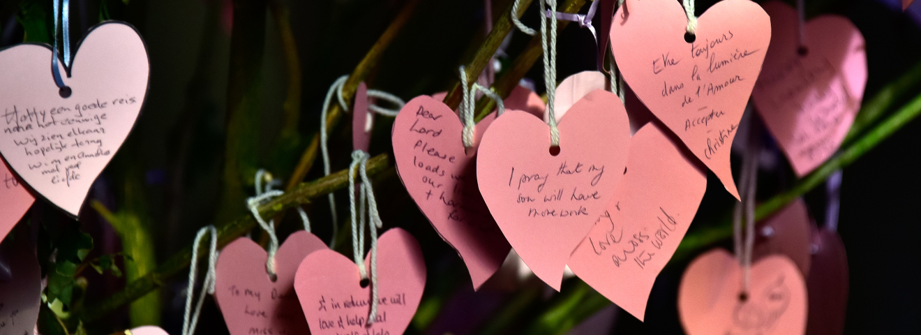paper hearts hanging in St James with Prayers written on them