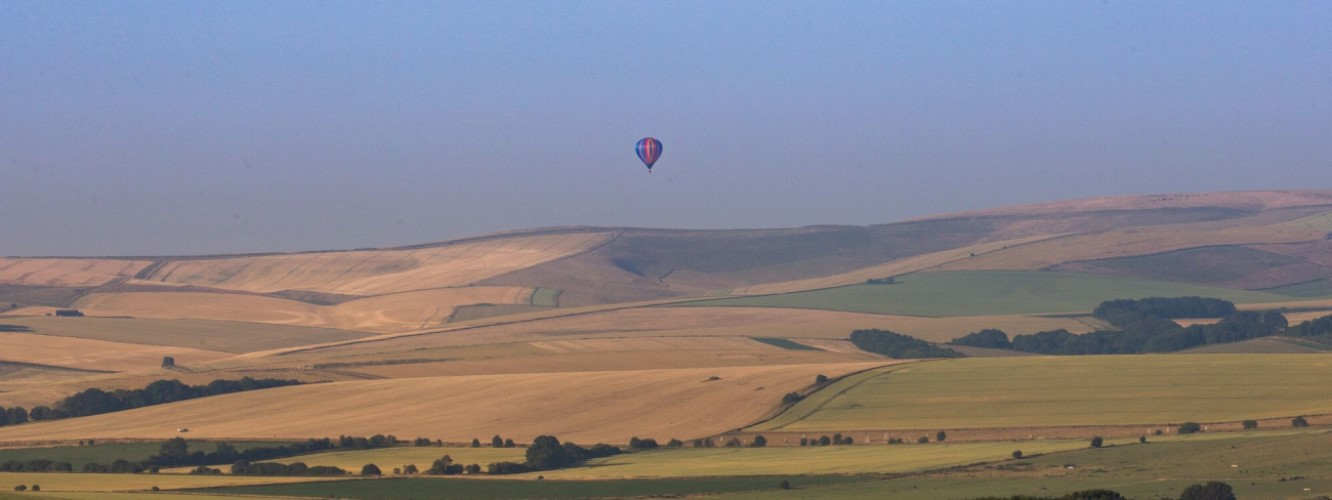 balloon floating above the Wiltshire downs