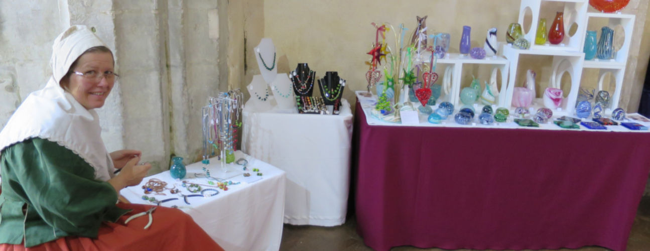 craftswoman making glass jewellery at the art fayre