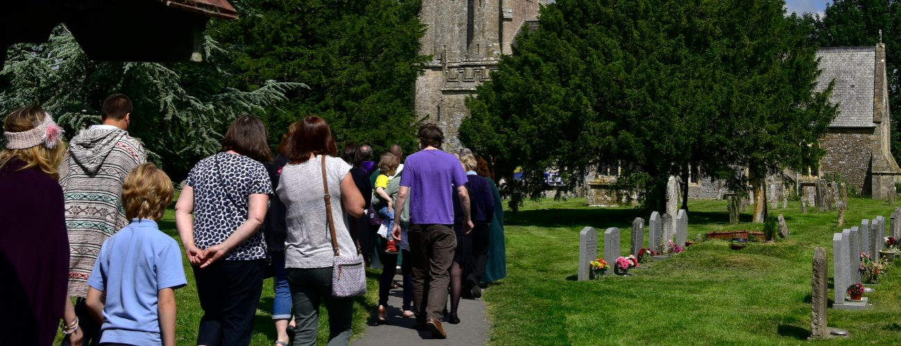 Walking group heading away from the camera into St James church