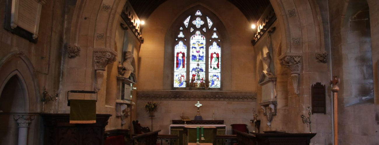 pulpit, altar and stained glass window at east Kennet